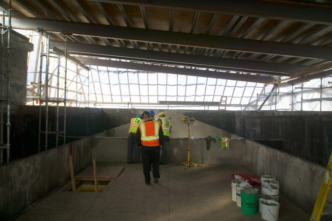 Reviewing the condition of the plaster inside the Unity House skylight.